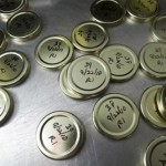 Jar caps noting when and what was canned