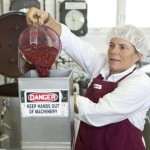 Anne pouring raspberries through a de-seeder